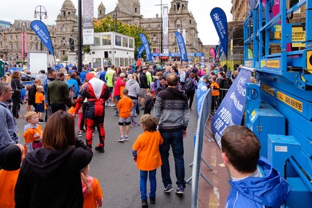 Glasgow, Scotland, UK - September 29, 2018: The City Centre of Glasgow, George Square with children and mums and dads getting ready for the annual family fun run supported by the bank of Scotland.