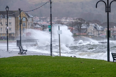 Largs, Scotland, UK - February 08, 2019: The Town of Largs is hit by storm Eric as torential rain waves and high winds buffet the town and seafront causing the A78 Coastal road out of the town to be closed for several hours. Banco de Imagens - 119470733