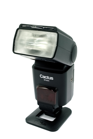Largs, Scotland, UK - November 22, 2018: Cactus RF60X Camera Speed Light or Flash gun an inexpensive and popular flash strobe and isolated on a white background. Editorial