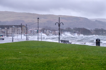 Largs, Scotland, UK - February 08, 2019: The Town of Largs is hit by storm Eric as torential rain waves and high winds buffet the town and seafront causing the A78 Coastal road out of the town to be closed for several hours. Éditoriale