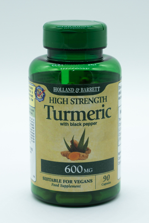 Largs, Scotland, UK - November 29, 2018: Holland & Barrett Turmeric Capsules in recyclable plastic bottle in line with current recycling UK guidelines Sajtókép