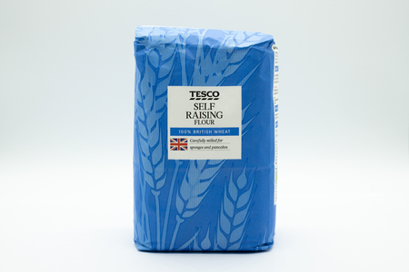 Largs, Scotland, UK - November 29, 2018: Tesco branded self raising flower in recyclable paper bag in line with UK recycling guidelines.