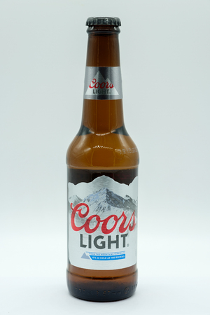 Largs, Scotland, UK - February 04, 2019: A Bottle of Coors Light Lager Beer in glass bottle that can be recycled across all UK Local Authorities.