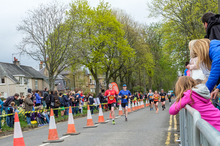 Stirling, Scotland, UK - April 29, 2018: Marathon runners of the first Srirling marathon and half marathon as they near the end of the half marathon. The first of what is to become an annual event in the Sottish city.