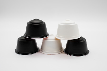 Five coffee refill pods from a modern type home coffee machine on a white background. He pods in this image are fully recyclable.