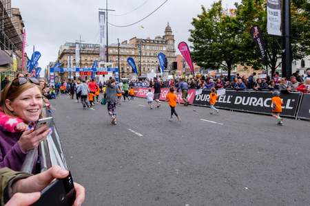 Glasgow, Scotland, UK - September 29, 2018: The City Centre of Glasgow, George Square with children and mums and dads taking part the annual family fun run supported by the bank of Scotland.