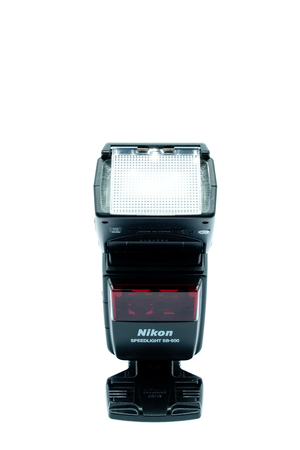Largs, Scotland, UK - November 22, 2018: Nikons Speed Light SB-600 which is one of their earlier speed lights from several years ago and popular amoungst  photographers being  TTL (through the lens) enabled.