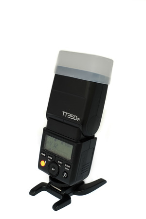 Largs, Scotland, UK - November 22, 2018: Godox TT350f for Fujifilm Mirrorless systems Camera Speed Light or Flash gun and isolated on a white background Editorial