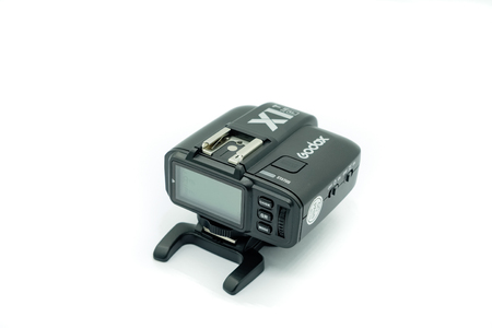 Largs, Scotland, UK - November 22, 2018: X1T f Wireless Trigger for Fujifilm Cameras fast becoming an affordable alternative to the more expensive studio wirteless triggers and Isolated on White Backg