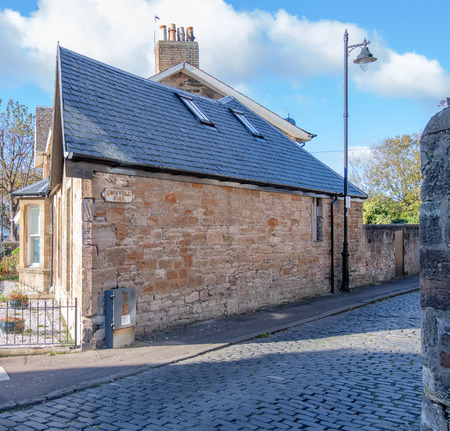 Ayr, Scotland, UK - October 26, 2018:  Near the seafront at Ayr is Cromwell Road with its cobbled streets, lanes and developed traditional properties. Editorial