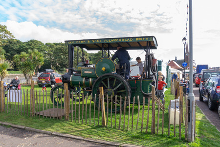 Largs, Scotland, UK - September 2018: Ancient Steam Driven Ayrshire Tractor and visitors to Largs enjoying the annual food festival held in conjunction with the Viking festival bringing much needed tourism to the Scottish town. Editorial