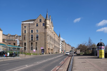 Dundee, Scotland, UK - March 23, 2019: Looking up Victoria Road in Dundee with its impressive traditional buildings situated in the old part of the city of Dundee in Scotland.