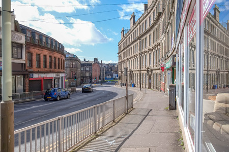 Dundee, Scotland, UK - March 23, 2019: Looking down Victoria Road in Dundee with its impressive traditional buildings situated in the old part of the city of Dundee in Scotland. Editorial