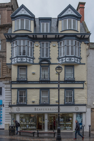 Dundee, Scotland, UK - March 22, 2019: Looking up to some impressive architecture Beaverbrooks Jewellers, that can be seen in the city centre of Dundee in Scotland.