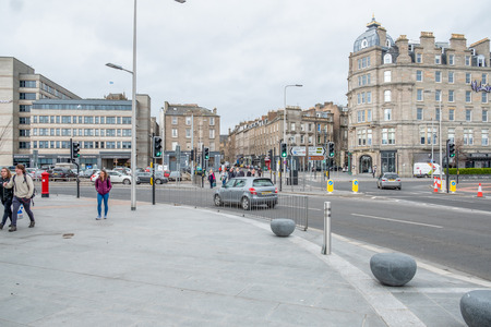 Dundee, Scotland, UK - March 22, 2019: A busy road junction within Dundee City centre at Whitehall Cres and Union St looking up towards Whitehall House all part of the Waterfront Developement.