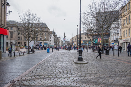 Dundee, Scotland, UK - March 22, 2019: High Street in the City Centre of Dundee with its Impressive Cobbled Streets and Architecture Scotland