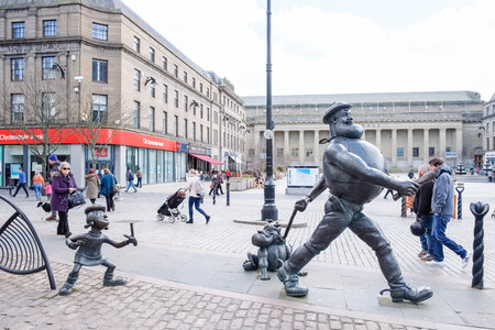 Dundee, Scotland, UK - March 23, 2019: Desperate Dan and other character Statues within Dundee city Centre with the Caird Hall in the background Editorial