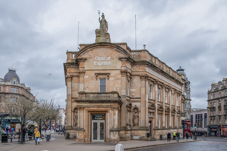 Dundee, Scotland, UK - March 22, 2019: The impressive architecture of what was the old Clydesdale Bank now Optical Express in Dundee Scotland. Editorial
