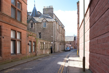 Dundee,Scotland, UK - March 23, 2019: Looking down one of Dundees ancient streets, Royal Exchange Lane, which is steeped in Dundees commercial history.