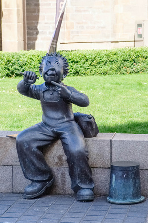 Dundee, Scotland, UK - March 23, 2019: Albert Square in Dundee outside the McManus gallery is the small figured statue of well known 'Oor Wullie' a Scottish legend and part of Scotlands humour.