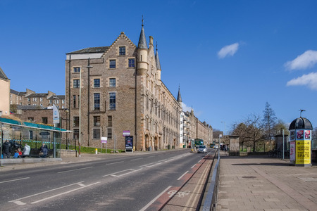 Dundee, Scotland, UK - March 23, 2019: Looking up Victoria Road in Dundee with its impressive traditional buildings situated in the old part of the city of Dundee in Scotland. Editorial