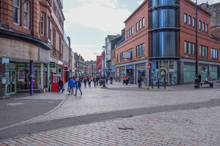 Dundee, Scotland, UK - March 23, 2019: People busy shopping in Cowgate and Constable Street in the City Centre of Dundee in Scotland.