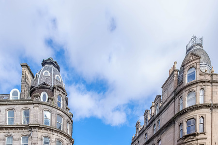 Dundee, Scotland, UK - March 23, 2019: Some of the impressive architecture in Dundee's City Centre when you look up to the rooftops within the city. Editorial