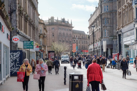 Dundee, Scotland, UK - March 23, 2019: People busy shopping looking down from Wellgate in the City Centre of Dundee in Scotland where empty shop premises can be seen.