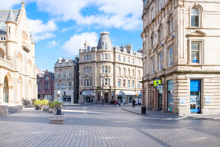 Dundee, Scotland, UK - March 23, 2019: A quiet Albert Square in Dundee's City centre as retail parks take business away from Scottish High Street.