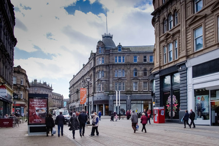Dundee, Scotland, UK - March 23, 2019: People busy shopping in the City Centre of Dundee in Scotland although many shop premises were empty.