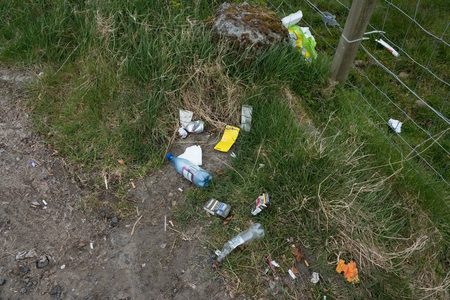 Troon, Scotland, UK - April 14, 2019: Roadside dumping and polluting on one of Scotlands most beautiful hillside landscapes near Troon on the West Coast of Scotland.
