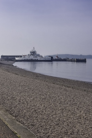 Largs Pier and the Cal-Mac ferry on an unusually warm day for the Easter weekend in Scotland.