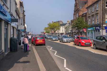 Largs, Scotland, UK - April 20, 2019:  The busy town of Largs with heavy traffic and visitors to the town centre.