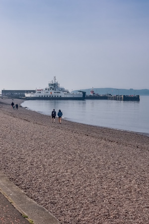 Largs, Scotland, UK - April 20, 2019: Largs Pier and the Cal-Mac ferry on an unusually warm day for the Easter weekend in Scotland.