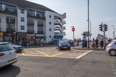 Largs, Scotland, UK - April 20, 2019: The town centre of Largs busy on the Easter weekend with cars and people visiting the town.