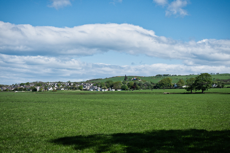 Ayrshire Fields and a views across to the town of Loans and to the High Grove hillside in Scotland.