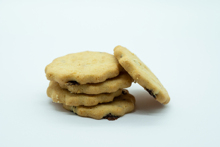 Five Delicious Crumbly Shortbread Raisin Biscuits on a white background A good image for a bakery or delicatessen or pastry chef.
