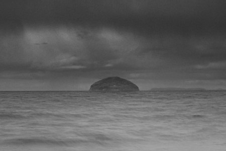 Torrential rain on Ailsa Craig taken from the foreshore at Girvan in Scotland.