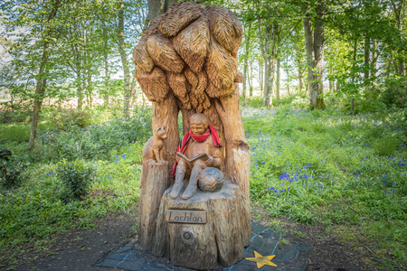 Troon, Scotland, UK - May 04, 2019: Lachlan Carving at Fullerton park in Troon in memory of a young child who died after falling from a tree within the park. It is set amongst beautiful woodlands in the park.