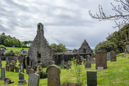 Kirkoswold, Scotland, UK -  May 06, 2019: The old Kirk Yard and Old Kirk ruins, the burial place of many of Robert Burn's characters including his grand parents.