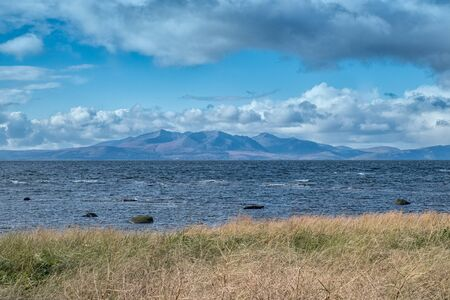 The Majestic Isle of Arran from Seamill on the West Coast of Scotland on a cold Breezy day in winter.