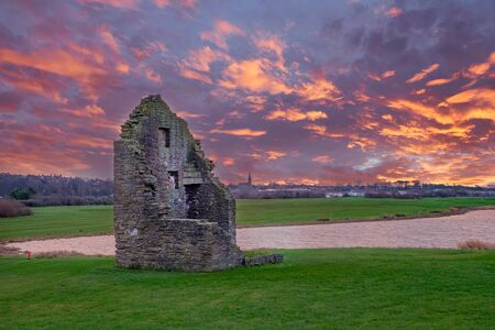 The remains of the old Engine House that served Auchenharvie Colliery in the Ayrshire town of Ardeer in Stevenston North Ayrshire Scotland. at sunset end of the day.