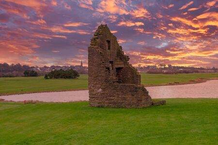 The remains of the old Engine House that served Auchenharvie Colliery in the Ayrshire town of Ardeer in Stevenston North Ayrshire Scotland. Dated around the 18th Century. All at sunset