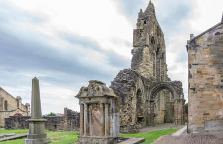Kilwinning, Scotland, UK - June 11, 2018:   The ancient ruins of Kilwinning Abbey and the old Clock Tower that stands over the abbey.