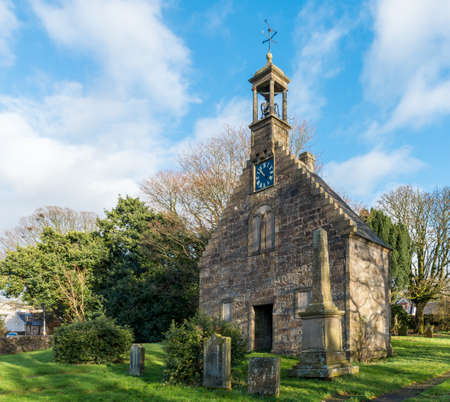 Lochwinnoch,Scotland,UK-November 18,2017: The early 18th-century St Johns Church, also known as Auld Simon (whose front gable still stands at the eastern end of the High Street), was probably built
