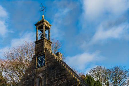 Lochwinnoch,Scotland,UK-November 18, 2017:  The early 18th-century St Johns Church and its Weather vane with plogh design on Saint Johns Kirk., also known as Auld Simon (whose front gable still st 報道画像