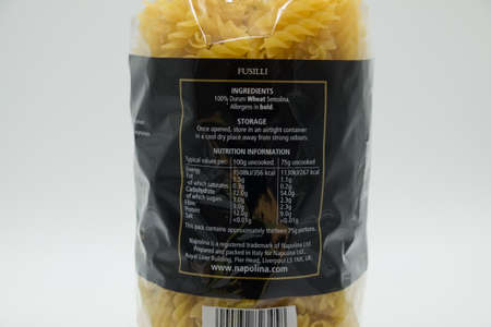 Irvine, Scotland, UK - April 18, 2020: Napolina branded bag of Fusilli Italian Pasta in plastic bag showing nutritional content that will be recyclable in most UK local authorities and in short supply at present due to Covid-19 panic buying.