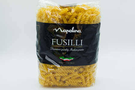 Irvine, Scotland, UK - April 18, 2020: Napolina branded bag of Fusilli Italian Pasta in plastic bag that will be recyclable in most UK local authorities and in short supply at present due to Covid-19 panic buying.