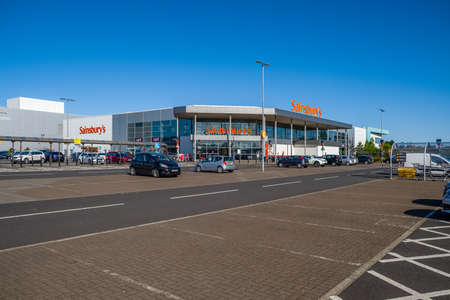 Irvine, Scotland, UK - May 11, 2020: Sainsbury's Supermarket  Riverview Retail Park, Scotland. During a quiet period and one of the new retail facilities in the West of Scotland during Covid-19 lockdown. Editorial
