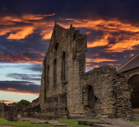 The Old Transept Ancient Ruins Kilwinning Abbey Scotland thought to be dated arround 1160's. Impressive ruins at sunset.